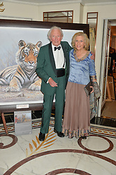 Artist DAVID SHEPHERD and his wife AVRIL at the David Shepherd Wildlife Foundation Wildlife Ball at The Dorchester, Park Lane, London on 9th October 2015.