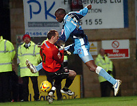 Photo: Kevin Poolman.<br />Wycombe Wanderers v Hereford United. Coca Cola League 2. 01/01/2007. Fola Onibuje of Wycombe can't steer the ball into the net around Hereford keeper Wayne Brown.