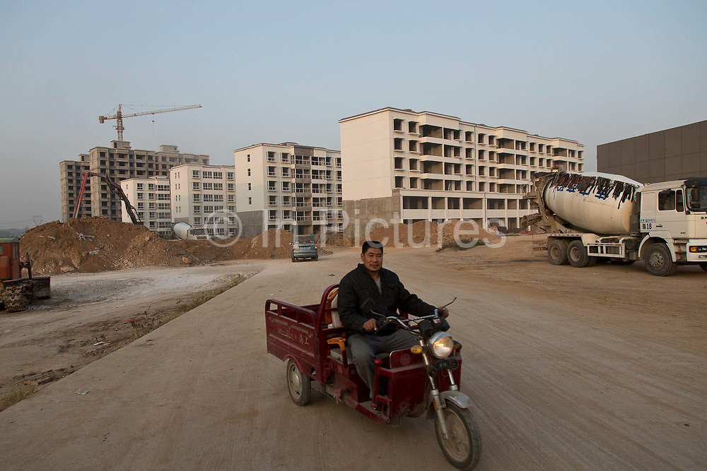 """A """"new village"""" being built on the rural outskirts of  Dengfeng, Henan Province, China on 23 October,  2013. Once the home to some 200 people, the village of Maijieping has seen its numbers dwindled to only four permanent  residents as most have moved to more convenient locations with access to jobs, schools, and hospitals."""