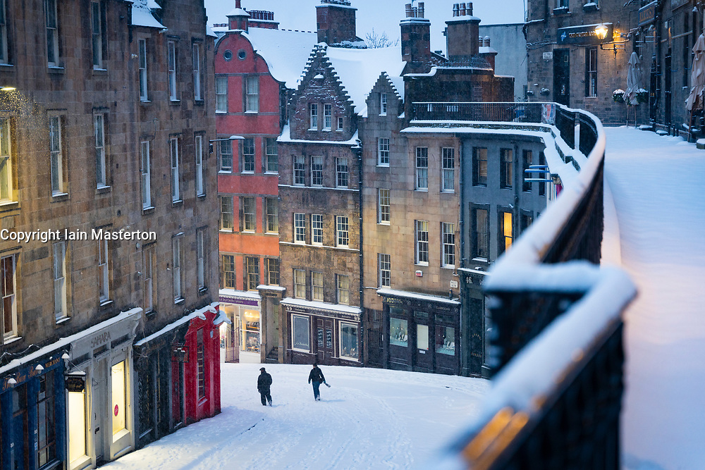 Edinburgh, Scotland, UK. 10 Feb 2021. Big freeze continues in the UK with heavy overnight and morning snow in the city. Pic; Snow covered Victoria Street in the early morning.  Iain Masterton/Alamy Live news