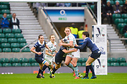 Twickenham, Surrey. UK.  Cambridge, centre, Mary COLMAN, running with the ball as the  Oxford defence gather around her, during the 2017 Women's Varsity Rugby Match, Oxford vs Cambridge Universities. RFU Stadium, Twickenham. Surrey, England.<br /> <br /> Thursday  07.12.17  <br /> <br /> [Mandatory Credit Peter SPURRIER/Intersport Images]