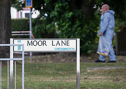 © Licensed to London News Pictures. 26/07/2019. Chessington, UK. A police forensics officer works on Moor Lane in Chessington, south west London where a man died after being hit by a car late last night. Police were called to a car in collision with a man on Moor Lane in Chessington at 00:13hrs on Friday, 26 July. The driver did not stop and the man was dragged under the car for some distance. Emergency services arrived an the man, believed to be aged 25 years, was pronounced dead on Moor Lane. Police believe they know the man's identity and his next of kin have been informed. Formal identification and a post-mortem examination will be arranged in due course.There has been no arrest. Enquiries are underway to establish the full circumstances. Photo credit: Peter Macdiarmid/LNP