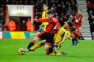 Alex Oxlade-Chamberlain (15) of Arsenal makes a tackle on Ryan Fraser of AFC Bournemouth in the 18 yard box during the Premier League match between Bournemouth and Arsenal at the Vitality Stadium, Bournemouth, England on 3 January 2017. Photo by Graham Hunt.
