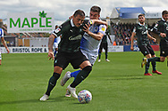 Michael Kelly (28) of Bristol Rovers holds up Antoni Sarcevic (7) of Plymouth Argyle during the EFL Sky Bet League 1 match between Bristol Rovers and Plymouth Argyle at the Memorial Stadium, Bristol, England on 8 September 2018.