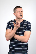 """Russell Tovey, one of Britain's more famously """"out"""" actors. After a string of straight roles, including the tough Rudge in """"The History Boys"""" and the slacker Steve in """"Him & Her,"""" he is premiering in his first gay roles: as Kevin, the boss (and potential love interest) of Patrick on """"Looking,"""" the new HBO series, and as a footballer in the London play """"The Pass."""" Photographed in the Royal Court Theatre, Sloane Square, London, Britain."""
