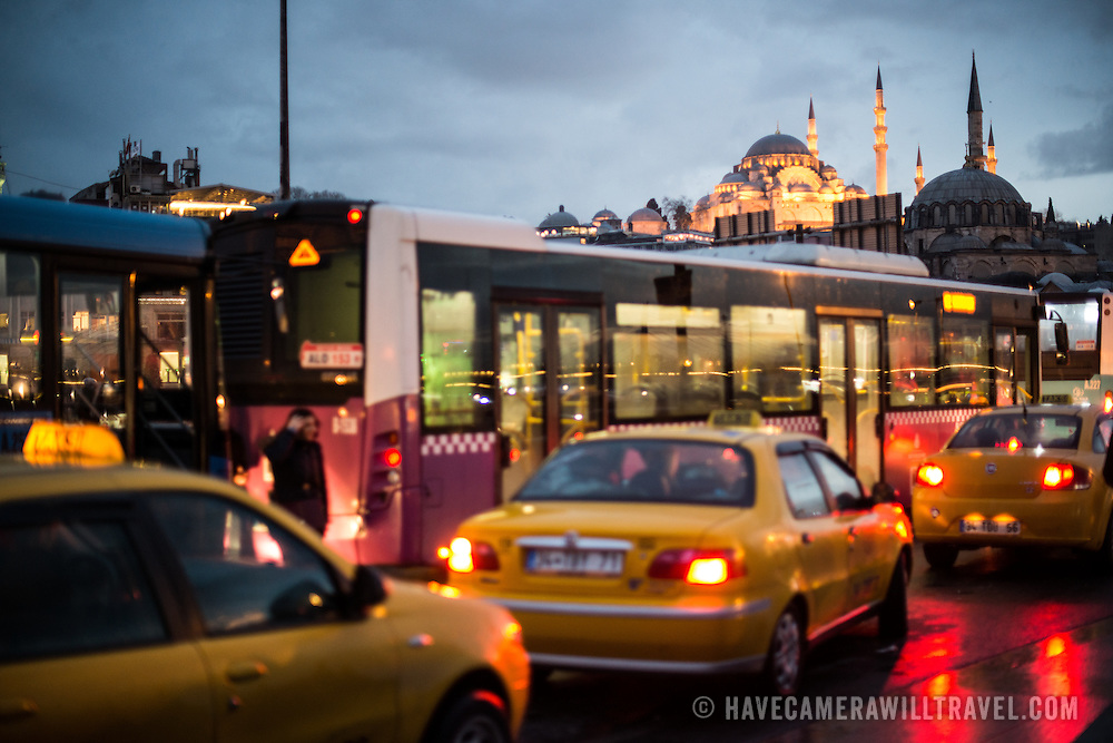 Traffic backs up after crossing the Galata Bridge in the Eminonu quarter of Istanbul. Suleymaniye Mosque is in the background.