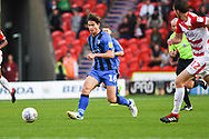 Billy Bingham of Gillingham (16) passes the ball forward during the EFL Sky Bet League 1 match between Doncaster Rovers and Gillingham at the Keepmoat Stadium, Doncaster, England on 20 October 2018.