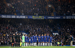 Chelsea and Crystal Palace players and match officials during a minute's silence in memory of the victims of the Leicester City helicopter crash which included Chairman Vichai Srivaddhanaprabha prior to the Premier League match at Stamford Bridge, London.