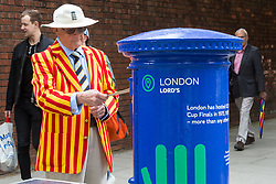 """Norman Dawson from Abingdon posts a letter in one of the special edition postboxes -<br /> created in collaboration with the International Cricket Council – outside Lord's<br /> Cricket Ground in London. To mark the launch of the ICC Cricket World Cup<br /> this week, the Company has decorated postboxes across the UK in each host<br /> city for the tournament, in honour of the quintessentially British game. The<br /> postboxes are located in London, Manchester, Nottingham, Chester-Le-<br /> Street, Cardiff, Bristol, Southampton, Birmingham, Taunton and Leeds, and<br /> will be transformed for the duration of the tournament."""". Lords Cricket Ground, London, May 28 2019."""
