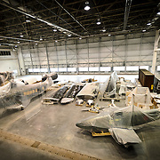 Pieces of planes partially unwrapped from their shipping crates in the restoration and preservation hangar at the Smithsonian National Air and Space Museum's Udvar-Hazy Center, a large hangar facility at Chantilly, Virginia, next to Dulles Airport and just outside Washington DC.