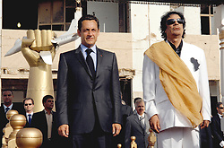 File photo - Libya's President Moammar Gadhafi and his counterpart from France Nicolas Sarkozy listen to national anthems at Bab Azizia Palace in Tripoli, Libya on July 25, 2007. France and Libya on Wednesday signed a memorandum of understanding to build a Libyan nuclear reactor for water desalination and clinched a raft of other deals. Former French President Nicolas Sarkozy was in police custody on Tuesday morning March 20, 2018, an official in the country's judiciary said. He was to be questioned as part of an investigation into suspected irregularities over his election campaign financing, the same source added. The probe related to alleged Libyan funding for Sarkozy's 2007 campaign, Le Monde newspaper reported. Photo by Christophe Guibbaud/ABACAPRESS.COM