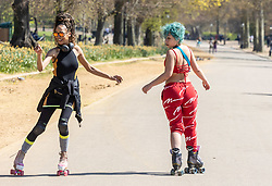 Licensed to London News Pictures. 19/04/2021. London, UK. Roller skaters soak up the sunshine in Hyde Park, London a week after the easing of Covid-19 restrictions as a mini heatwave hit the UK this week with temperatures reaching up to 18c in London and the South East. Photo credit: Alex Lentati/LNP