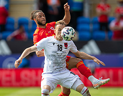 CARDIFF, WALES - Saturday, June 5, 2021: Wales' Tyler Roberts (L) and Albania's Ardian Ismajli during an International Friendly between Wales and Albania at the Cardiff City Stadium in their game before the UEFA Euro 2020 tournament. (Pic by David Rawcliffe/Propaganda)