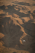 Aerial view of light aircraft and desert mountains, Skeleton Coast, hoanib river, Northern Namibia, Southern Africa