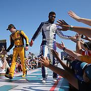 Erik Jones (L) and Darrell Wallace Jr. are seen during driver introductions for the 60th Annual NASCAR Daytona 500 auto race at Daytona International Speedway on Sunday, February 18, 2018 in Daytona Beach, Florida.  (Alex Menendez via AP)