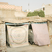 Cars are protected from the heat with blankets.