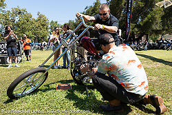 BF11 invited builder Oliver Jones working hard to kickstart his Harley-Davidson UL Flathead / Knucklehead chopper at the Born-Free Vintage Motorcycle show at Oak Canyon Ranch, Silverado, CA, USA. Sunday, June 23, 2019. Photography ©2019 Michael Lichter.