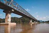 Hpa-An, Myanmar - October 28, 2011: A bridge spans the Thanlwin River near the city of Hpa-An in Myanmar's Kayin State. The 2,044-mile long river begins in the Tibetan Plateau and is generally known as the Salween River, with different names as it passes through different regions.
