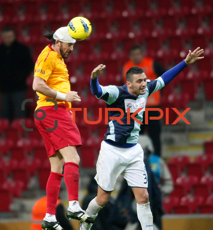 Galatasaray's Servet Cetin (L) during their Turkey Cup matchday 3 soccer match Galatasaray between AdanaDemirspor at the Turk Telekom Arena at Aslantepe in Istanbul Turkey on Tuesday 10 January 2012. Photo by TURKPIX