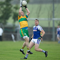 O'Curry's Sean Haugh catches the ball in the air watched by Kilkee's Conor King