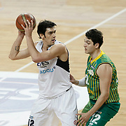 Efes Pilsen's Kerem GONLUM (L) and Olin Edirne's Caner ERCAN (R) during their Turkish Basketball league match Efes Pilsen between Olin Edirne at the Sinan Erdem Arena in Istanbul Turkey on Friday 06 May 2011. Photo by TURKPIX