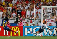 Photo: Glyn Thomas.<br />England v Ecuador. 2nd Round, FIFA World Cup 2006. 25/06/2006.<br /> England's Ashley Cole (C) makes a vital block to deny Ecuador's Carlos Tenorio in the first half.