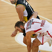 Fenerbahce Ulker's Omer ONAN (L) and Olimpiakos's Vassilis SPANOULIS (R) during their Two Nations Cup basketball match Fenerbahce Ulker between Olimpiakos at Abdi Ipekci Arena in Istanbul Turkey on Saturday 01 October 2011. Photo by TURKPIX