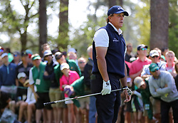 April 6, 2018 - Augusta, GA, USA - Phil Mickelson watches his tee shot on the fourth hole during the second round of the Masters at Augusta National Golf Club on Friday, April 6, 2018, in Augusta, Ga. (Credit Image: © Curtis Compton/TNS via ZUMA Wire)