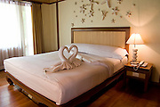 Southeast Asia, Thailand, Koh Chang resort Hotel, Towels arranged as swans on the bed in guest's room