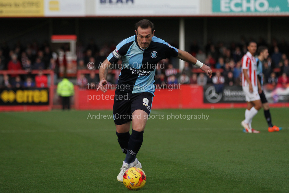 Paul Hayes of Wycombe crosses the ball for his side's first goal. Skybet football league two match, Cheltenham Town  v Wycombe Wanderers at The Abbey Business Stadium, Whaddon Road in Cheltenham, Glos on Saturday 22nd November 2014.<br /> pic by Mark Hawkins, Andrew Orchard sports photography.