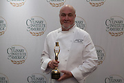 Larry Forgione with his award as a Pioneer of American Cuisine.
