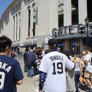 Japanese baseball fans arrive at Yankee Stadium on game day to see Masahiro Tanaka, New York Yankees, pitching during the New York Yankees Vs Tampa Bay Rays, Major League Baseball game at Yankee Stadium, The Bronx, New York. 3rd May 2014. Photo Tim Clayton