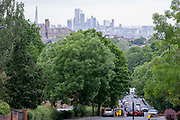 With the skyscrapers of the City of London, the capitals financial district, in the distance, rush-hour traffic builds at the bottom of Sydenham Hill, on 15th June 2021, in south London, England.