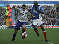 Photo: Lee Earle.<br /> Portsmouth v Chelsea. The Barclays Premiership. 03/03/2007.Chelsea's Andriy Shevchenko (L) battles with Djimi Traore.