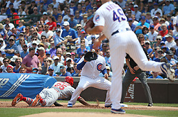 July 21, 2017 - Chicago, IL, USA - Chicago Cubs starting pitcher Jake Arrieta (49) throws to first baseman Anthony Rizzo (44) as St. Louis Cardinals second baseman Greg Garcia (35) dives back to first base in the first inning on Friday, July 21, 2017 at Wrigley Field in Chicago, Ill. (Credit Image: © John J. Kim/TNS via ZUMA Wire)