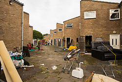 Properties on the Sweets Way housing estate close to the home of Mostafa Aliverdipour, its last remaining resident, on 23rd September 2015 in London, United Kingdom. A group of housing activists calling for better social housing provision in London had occupied some of the properties on the 142-home estate in Whetstone, in some cases refurbishing properties intentionally destroyed by the legal owners following eviction of the original residents, in order to try to prevent or delay the eviction of Mr Aliverdipour and the planned demolition and redevelopment of the entire estate by Barnet Council and Annington Property Ltd.