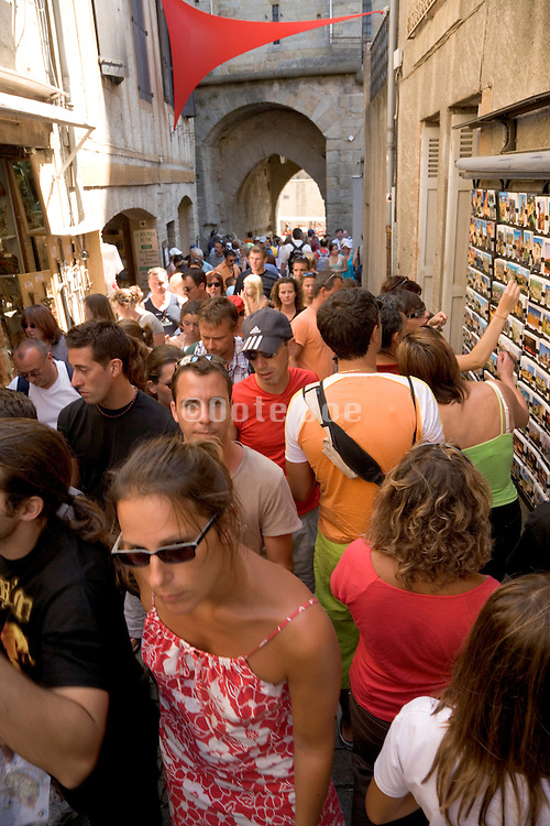 people cramped in a street at a tourist destination South France