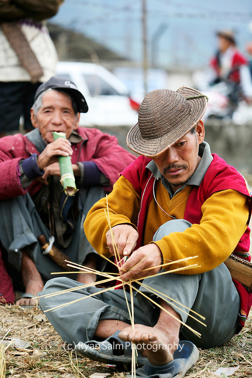 The men drink millet beer at Si Donyi