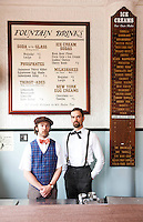 Brothers Eric (left) and Ryan Berley are co-owners of The Franklin Fountain in the historic Old City neighborhood of Philadelphia. They are pictured with the store's soda draft lamp, which was made about 1905, and restored by the brothers.