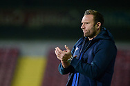 Bolton Wanderers manager Ian Evatt applauds, claps, applauding, clapping during the EFL Sky Bet League 2 match between Scunthorpe United and Bolton Wanderers at the Sands Venue Stadium, Scunthorpe, England on 24 November 2020.