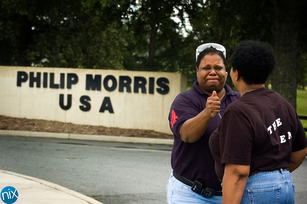 Philip Morris employees Sharon Johnson, left, and Mary Kendall say goodbye after their shift ended on the final day of production at the Concord cigarette plant Wendesday July 29.