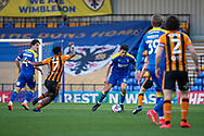 AFC Wimbledon defender Will Nightingale (5) dribbling and clearing ball during the EFL Sky Bet League 1 match between AFC Wimbledon and Hull City at Plough Lane, London, United Kingdom on 27 February 2021.