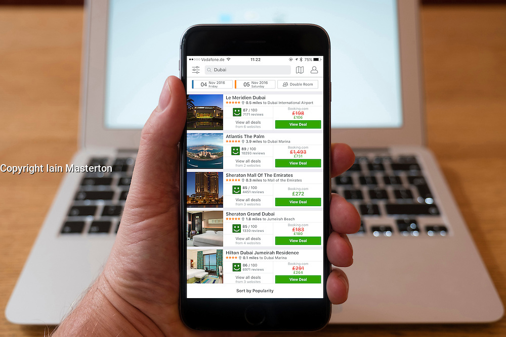 Using iPhone smartphone to display hotels listings in Dubai on Trivago booking website