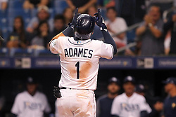 May 22, 2018 - St. Petersburg, FL, U.S. - ST. PETERSBURG, FL - MAY 22: Willy Adames (1) of the Rays steps on home plate and points to the heavens as he makes his Major League Debut this evening and in his second at bat, hits a home run off of Chris Sale of the Red Sox during the MLB regular season game between the Boston Red Sox and the Tampa Bay Rays on May 22, 2018, at Tropicana Field in St. Petersburg, FL. (Photo by Cliff Welch/Icon Sportswire) (Credit Image: © Cliff Welch/Icon SMI via ZUMA Press)