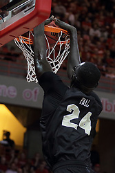 20 March 2017:  Tacko Fall stuffs the ball in the hoop after getting past Deontae Hawkins(23) during a College NIT (National Invitational Tournament) 2nd round mens basketball game between the UCF (University of Central Florida) Knights and Illinois State Redbirds in  Redbird Arena, Normal IL