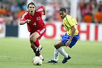 FOOTBALL - CONFEDERATIONS CUP 2003 - GROUP B - BRASIL V TYRKIA - 030623 - AKYEL FATIH (TUR) / GIL (BRA) - PHOTO JEAN MARIE HERVIO / DIGITALSPORT