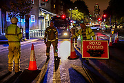 Members of Fire Brigade places traffic cones after an electricity link box, otherwise known as a manhole cover exploded on Monday, Sept 28, 2020 - outside Oval Underground Station in London. No reported injuries. Police, fire brigade and highway maintenance are currently at the scene. The station is currently closed as well as two lanes of Kennington Park Road. (VXP Photo/ Vudi Xhymshiti)
