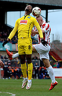 Jason Banton and Matt Richards challenge for a header during the Sky Bet League 2 match between Cheltenham Town and Plymouth Argyle at Whaddon Road, Cheltenham, England on 28 March 2015. Photo by Alan Franklin.