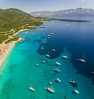 Aerial view of group of boats anchored on the shore of Varko, Greece.