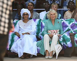 First Lady of the Gambia Fatou Bah-Barrow (left) with the Duchess of Cornwall (centre) watch a performance during a visit to St Teresa's School in Banjul, The Gambia, on day two of the royal couples trip to west Africa.